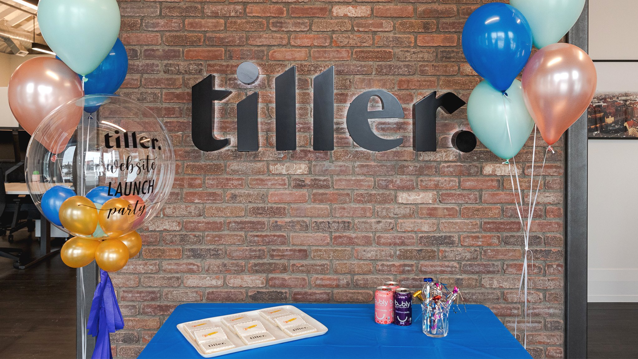 Picture of the Tiller website launch party with custom balloons and cookies.